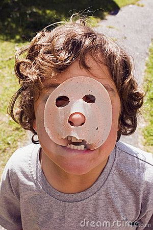 Boy with luncheon meat on face