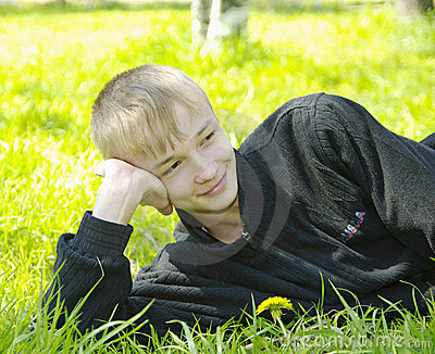 Boy lying on green
