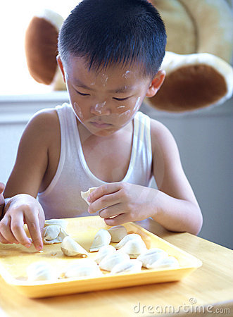 Free Boy Making Dumplings Stock Photos - 10015803