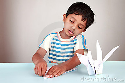 Boy making paper bird