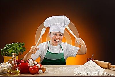 Boy making pizza dough