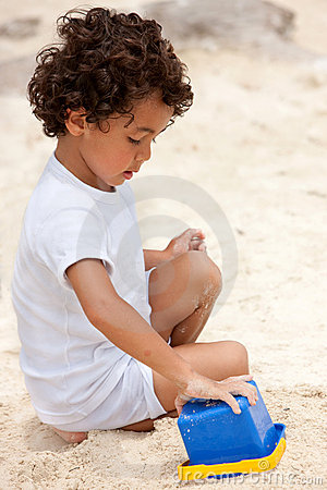 Boy making sand castle