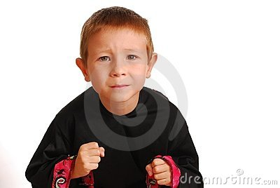 Boy in martial art suit