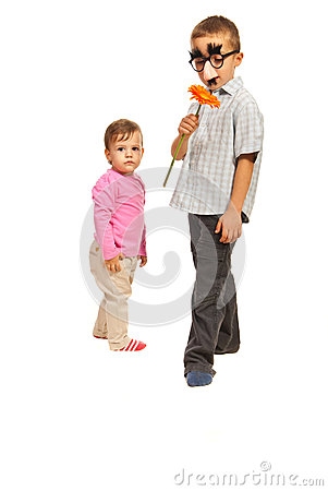 Boy with mask  and little girl