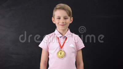 Boy with medal, prominent achievement in education, winning sport competition. Stock footage stock video footage