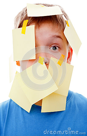 Boy with memo posts on his face