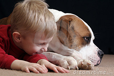 Boy mimics dog