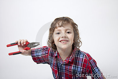 Boy with missing tooth and combination pliers