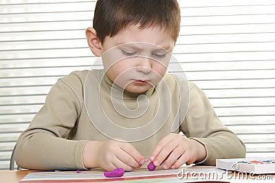 Boy modelling at desk