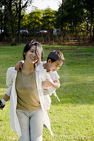 Boy and mother having fun on lawn