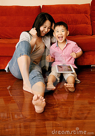 Boy and mother playing games with tablet