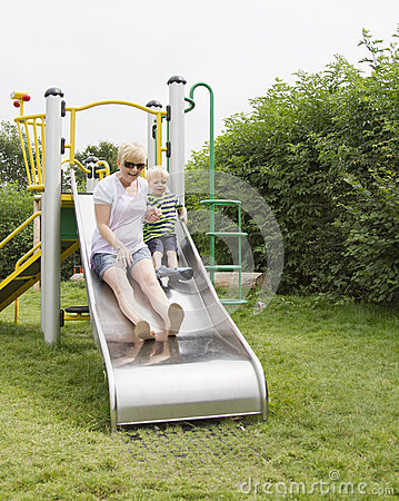 Boy with mother on slide
