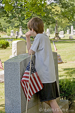 Free Boy Mourning At Gravesite Stock Photography - 5949882