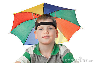 Boy with multi-coloured umbrella on head isolated