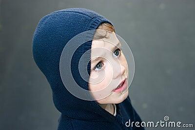 Boy in navy blue hood