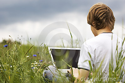 Boy with notebook on the field