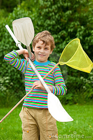 The boy with oars and a net outdoor