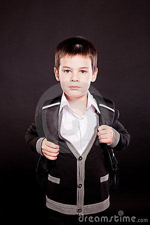 Boy in official dresscode with backpack