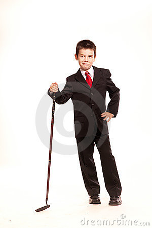 Boy in official dresscode with a golf club