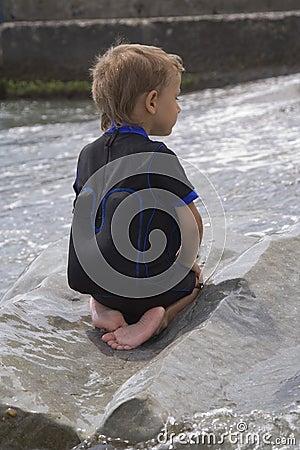Free Boy On A Large Wet Stone Royalty Free Stock Photo - 6143515