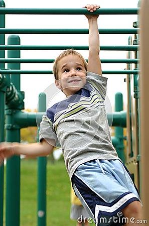 Free Boy On Monkey Bars Stock Photography - 1357052