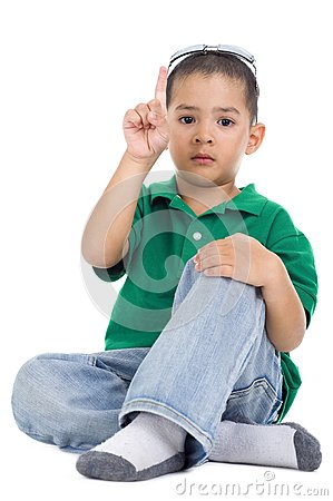Boy with one finger raised
