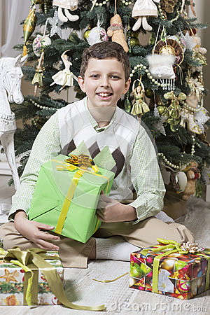 Boy is opening Christmas gifts