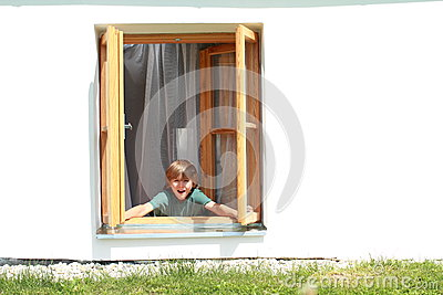 Boy opening the window