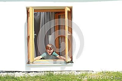 Boy opening the window