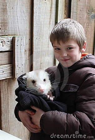 Boy with an Opossum
