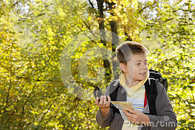 Boy orienteering in forest