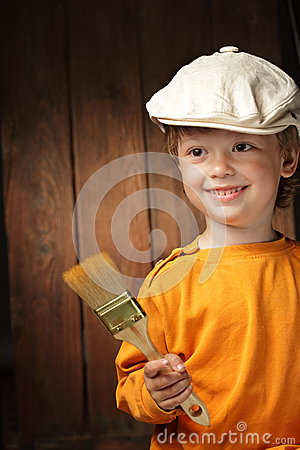 Boy with paint brush