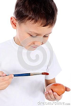 boy painting easter egg