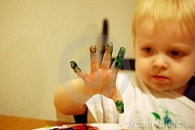 Boy paints with fingers