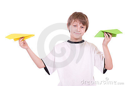 Boy with paper airplanes