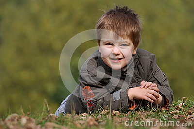 Boy in the park on the ground