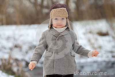 Boy in the park playing in the snow