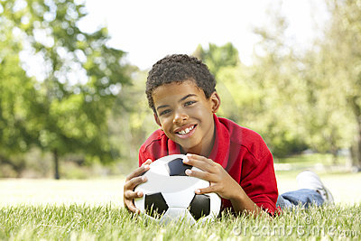 Boy In Park With Soccer Ball