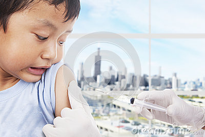 Boy patient scared of vaccine syringe