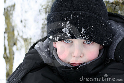 Boy piercing look in snow