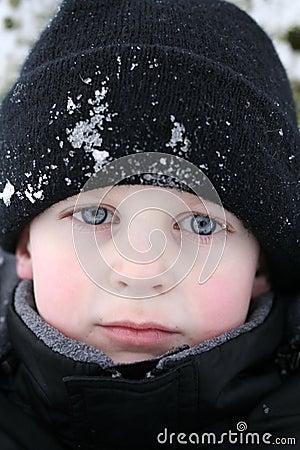 Boy piercing look in snow