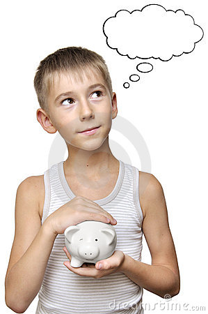 Boy with  piggy bank dreaming