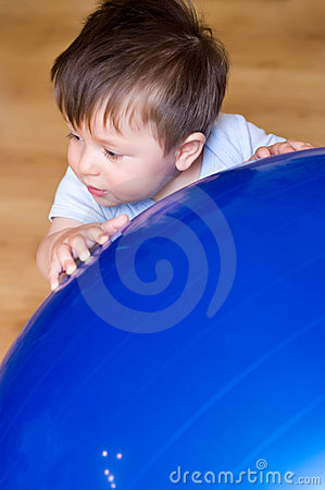 Boy with pilates ball