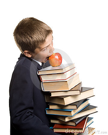 The boy and a pile of books