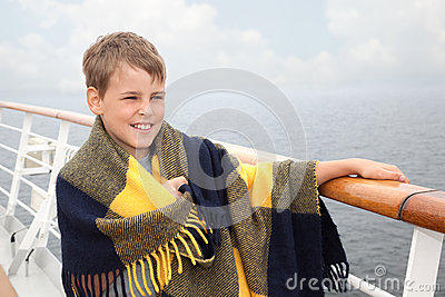 Boy in plaid on deck of ship
