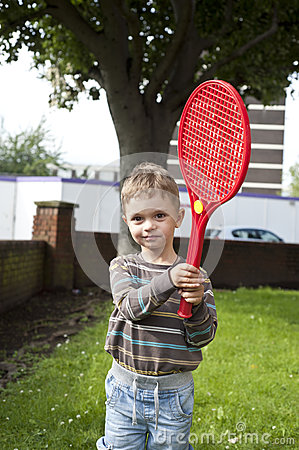 Boy with plastic racket