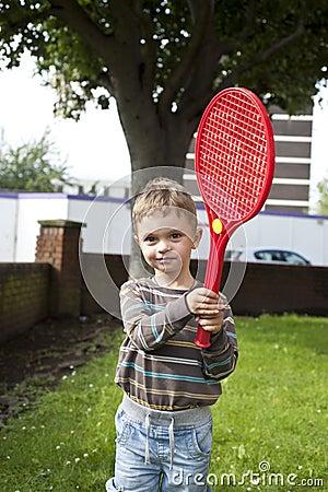 Boy with plastic racket