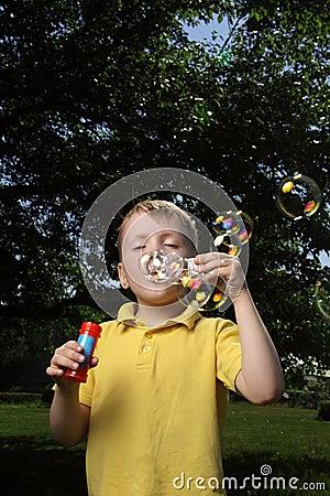 Boy play in  bubbles