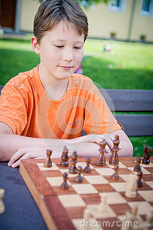 Boy play Chess with Concentration
