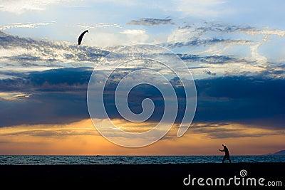 Boy play north wind on the beach